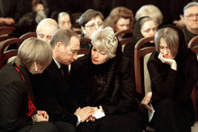 At a civil funeral with ex-mayor of Saint Petersburg Anatoly Sobchak. With widow Lyudmila Narusova and ex-mayor's daughter Ksenia. (Photo from kremlin.ru)