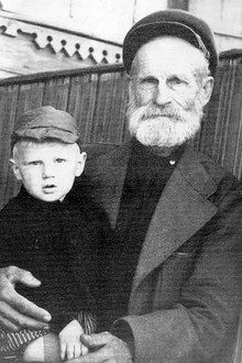 Sergey with his grandfather Feodor in 1956 (Photo from http://mironov.ru)
