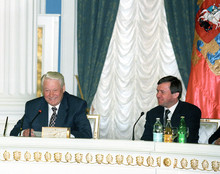 Russian President Boris Yeltsin and Kremlin Administration Head Valentin Yumashev during signing of agreement on delimiting terms of reference between the Federal Government and state power bodies of the Marii El Republic, the Amur, Voronezh, Ivanovo and Kostroma Regions, 1996. (RIA Novosti /  Vladimir Rodionov)