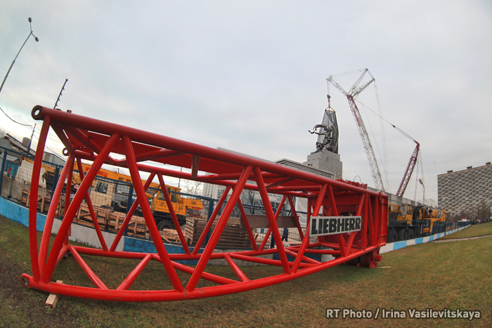 Soviet sculpture by Vera Mukhina installed with a special crane