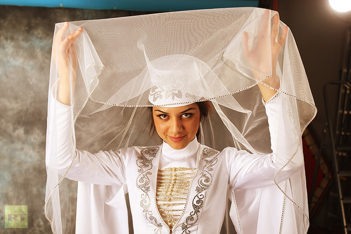 Mysterious charm of the North Caucasus: An Ossetian woman lifting the veil of her national wedding costume